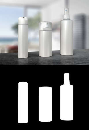perfume atomizer: Three white dispenser bottles or pump spray bottles without label on stone surface and blurred background