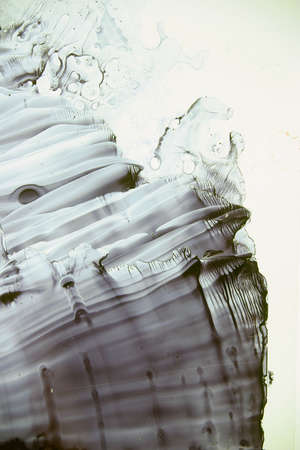 fluid: Abstract painting with black ink mixed in fluid Stock Photo
