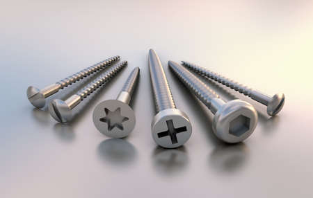 Six different metal screws next to each other on reflective underground Banco de Imagens