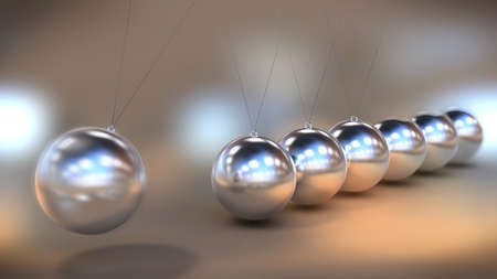 Illustration of a Newtons cradle in close up view
