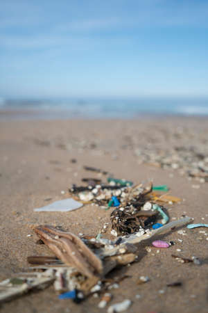 Plastic waste and micro plastic washed on the shore of the atlantic ocean