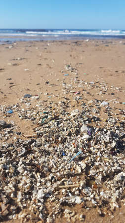 Plastic waste and micro plastic washed on the shore of the atlantic ocean Standard-Bild - 161947985