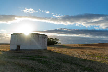 Round building in sunset in rural grass landscape in Andalusia in Spain