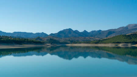 View on a beautiful mountain lake in Andalusia in Spain Standard-Bild - 163057270