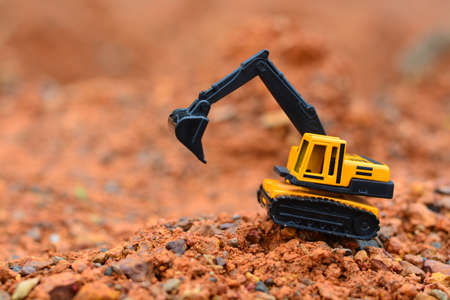 Excavator Toy work at construction site. Stock Photo