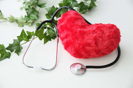 Heart with a stethoscope and green Stock Photo