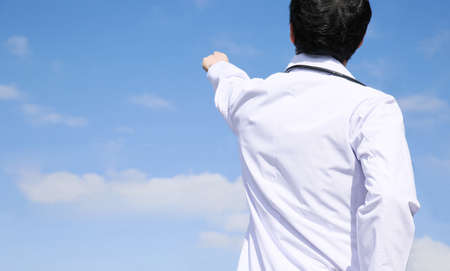 philosophic: Doctors pointed to the sky Stock Photo