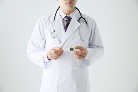 Male doctor with a thermometer