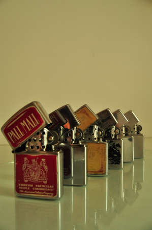 set of zippo lighters on glass