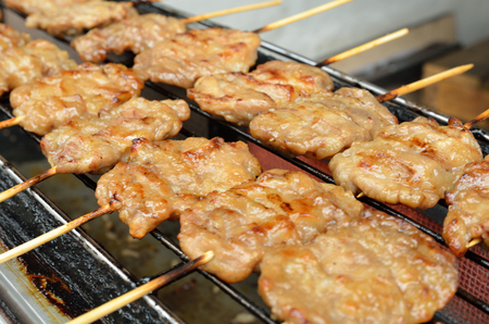 Pork skewers are cooked on a gas stove photo