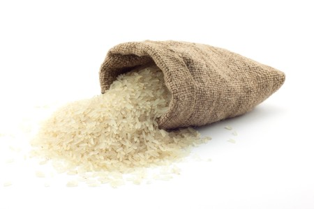 basmati: small bag of rice on a white background Stock Photo