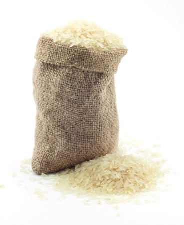 small bag of rice on a white background Stock Photo