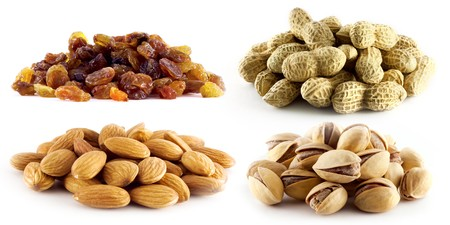 selection of raisins, peanuts, pistachios and almonds on white background