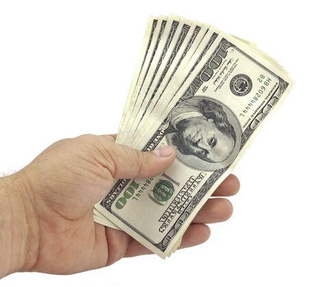 hand holds the hundred-dollar bills on white background