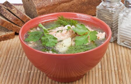 delicious soup of the trout with potatoes, carrots and parsley photo