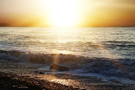 Sunset over the sea and beach for you design photo