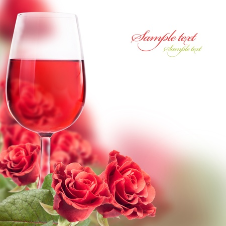 frame with a glass of wine and roses for your design photo