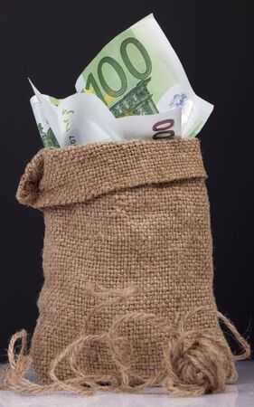 rescheduling: bag full of money. 100 Euro banknotes