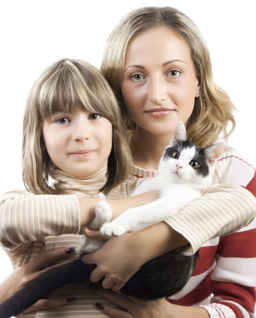 Mother and daughter holding a kitten on a white background photo