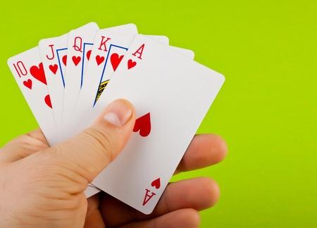 jeu de cartes: Royal Flush sur fond vert pour votre conception