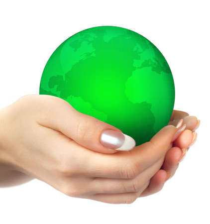 Hands holding a green earth on a white background photo
