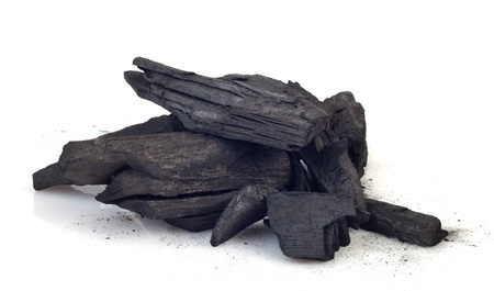 Piece of fractured wood coal isolated over white background