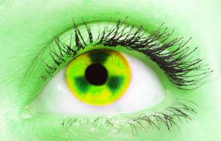 female eye with the pupil as a sign of radiation Stock Photo - 9259147