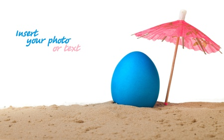 Easter egg on the beach under an umbrella photo