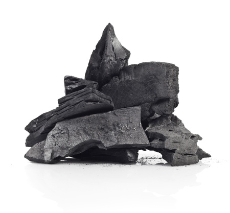 exploitation: Piece of fractured wood coal isolated over white background