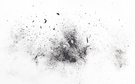 anthracite coal: particles of charcoal on a white background. Placer cosmetics