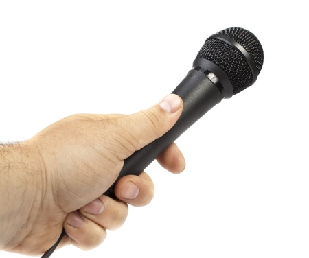 Hand Holding a Microphone  Stock Photo - 9740431