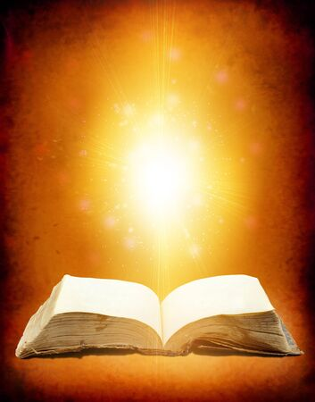 Old book with Ray of light  photo