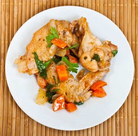 Fried chicken wings with vegetables decorated with parsley photo