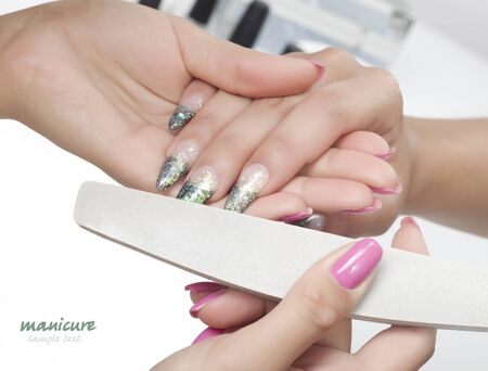 Beautiful woman hands with manicure Stock Photo - 9968699
