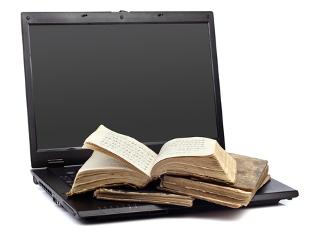ancient books: Old worn book with a laptop for your design Stock Photo