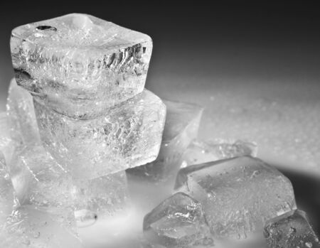 frozen solid: keeping an ice cube on a gray background for your design