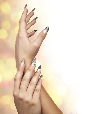 Womans hand with manicure on white background photo