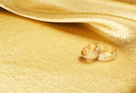 gold rings: Gold wedding rings lying on silk