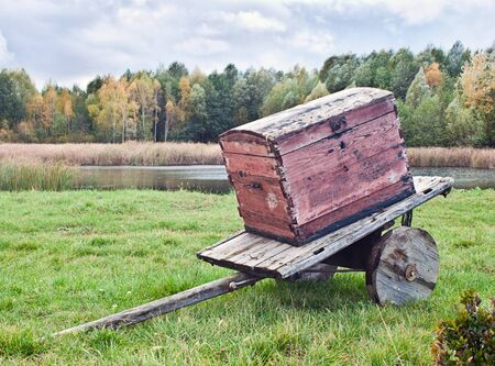 Old wagon with a chest against the autumn landscape Stock Photo - 10966420