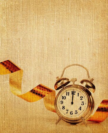 midnight: An old book papers with the clock and tape