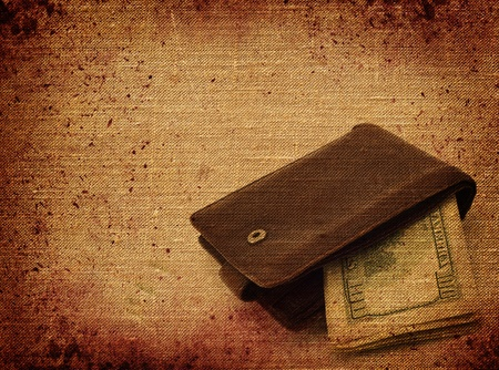 Background of old paper and a wallet with hundred dollar bills photo