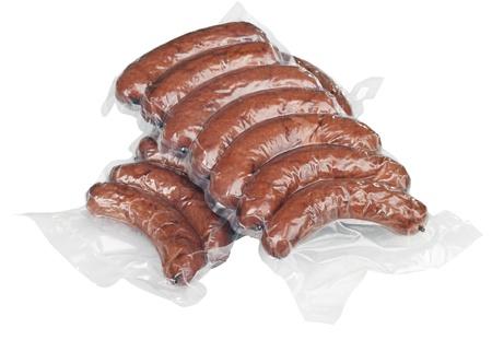 cellophane: Sausage on a white background