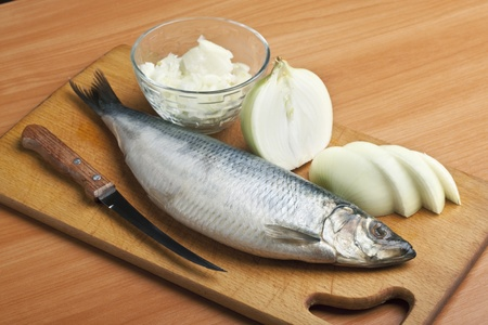Marinated herring on the kitchen blackboard photo