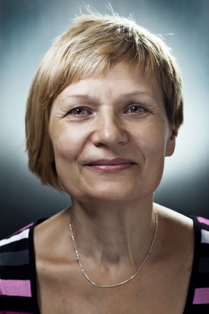 Content female senior citizen smiling. Against a dark background Stock Photo - 11931984