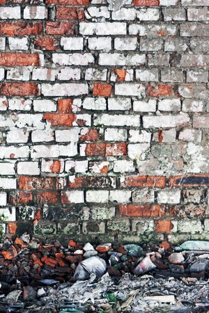 An old worn down red brick wall with plaster on the sides make a great background with copyspace Stock Photo - 12106367