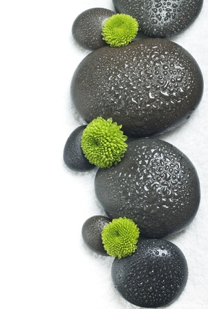 Spa stones with flowers on a white background
