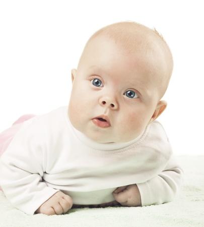 Little girl lying on tummy Stock Photo - 12692788