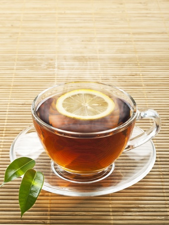 Hot black tea with lemon Stock Photo - 12979551