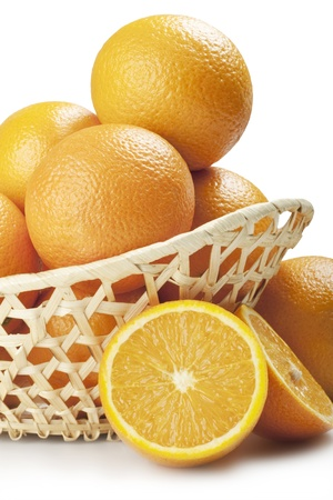 oranges in a beautiful basket isolated on white  photo