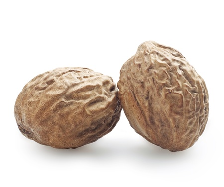 muscat: Two nutmeg on a white background